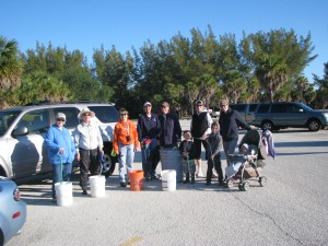 On a chilly April morning, members of The Adventurous Woman gather to cleanup trash at Fort De Soto