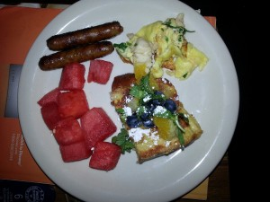 Orange French toast with blueberries (i.e. Gator french toast), lobster omelet, watermelon and sausage.