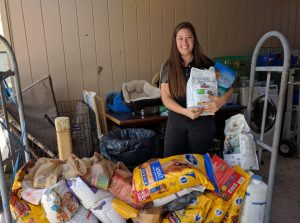 Vanessa Ply and the generous donations received from The Adventurous Woman, donated to the Humane Society during our monthly meeting.