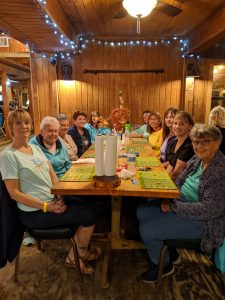 The Adventurous Woman's group dining at a restaurant near the Suwanee River