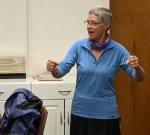 Amanda Hus shares stories from her hiking adventures at the November meeting of The Adventurous Woman.
